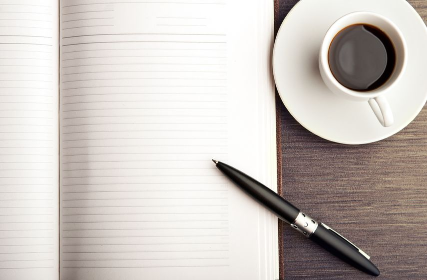 pen paper and coffee